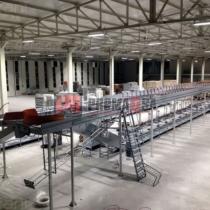 Transportador automatizado para organizar el departamento de costura.